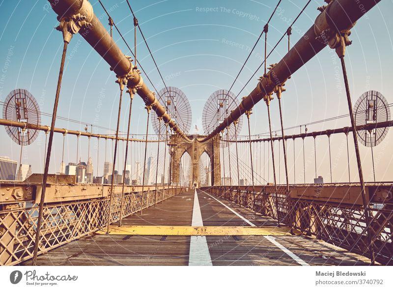 Retro toned picture of Brooklyn Bridge, New York City, USA. city building landmark travel cityscape architecture retro vintage bridge path effect filtered