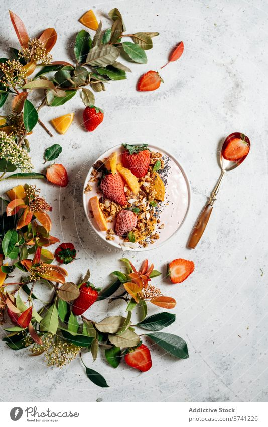 Healthy breakfast bowl with fruits on table smoothie bowl super food delicious nut nutrition healthy food raw food green plant muesli orange coconut fresh spoon