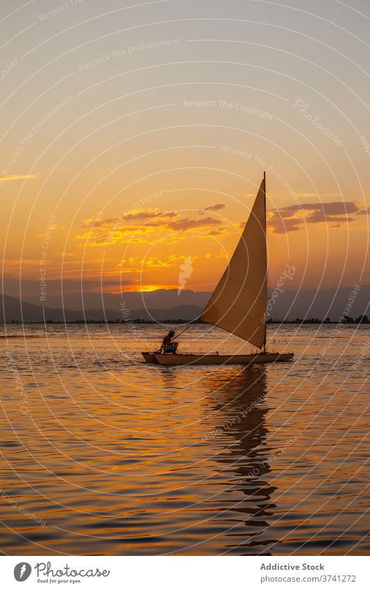 Sailing boat in the sea at sunset sailing clouds colours sunrise peace sunshine dream panoramic colourful trip wave relaxation romantic dusk silhouette freedom