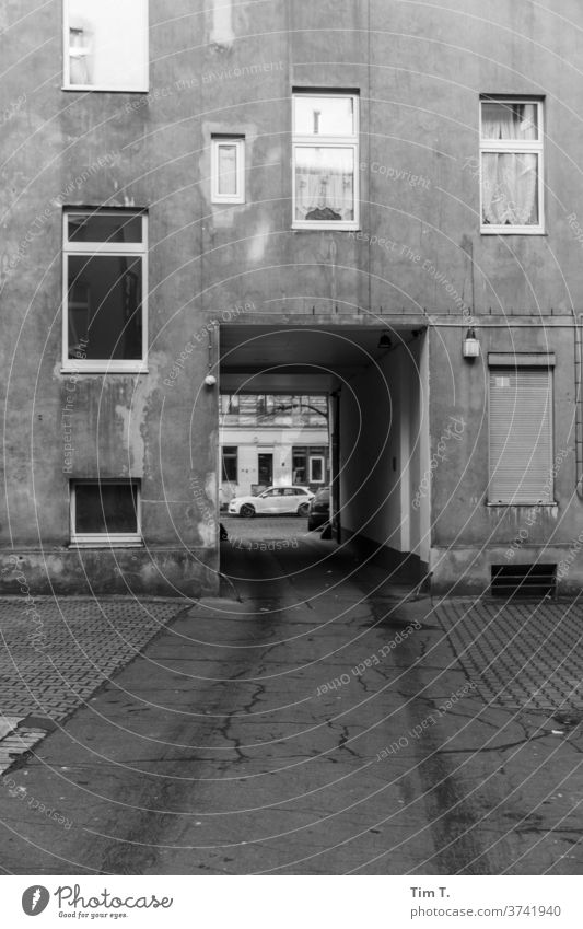 Last exit Berlin Backyard passage Black & white photo Window House (Residential Structure) Facade Town Deserted Downtown Capital city Exterior shot Day Old town