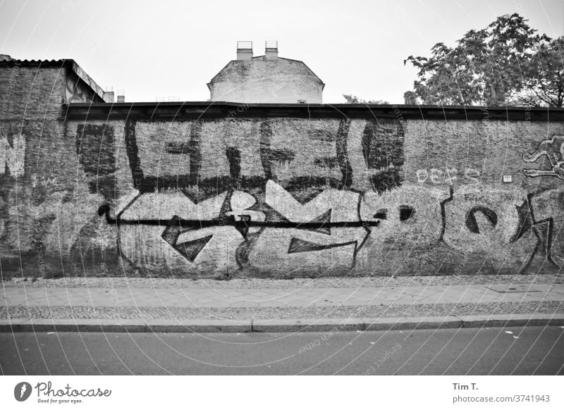 Berlin Lichtenberg is still special Graffiti Black & white photo Town Exterior shot Capital city Day Deserted Downtown Old town House (Residential Structure)