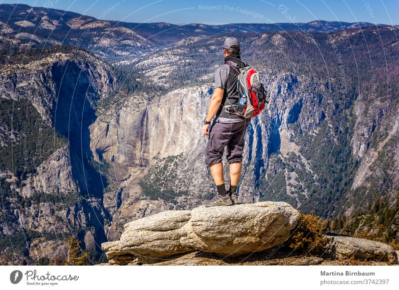 Backpacking in the Yosemite National Park, man enjoying the view hike yosemite backpacking viewpoint vacation caucasian glacier point yosemite valley landscape