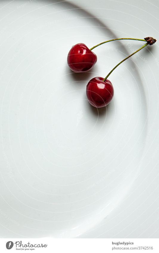 Two cherries on a white plate Cherry sour cherries Plate sweet cherry fruit Fresh Sweet Mature Summer Food Minimalistic Glittering Harvest Red Juicy