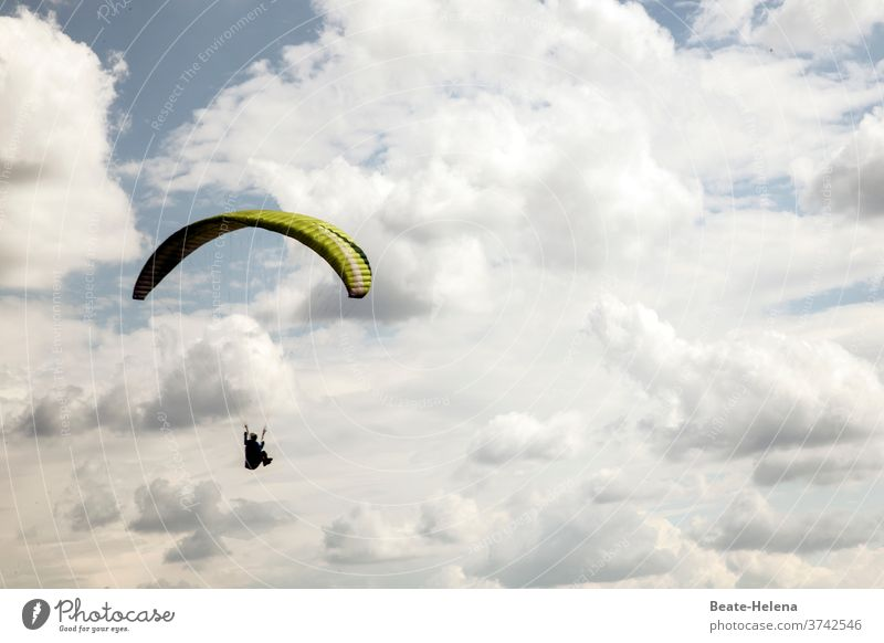 Paraglider in cloudy sky: lifted paraglide paragliding umbrella paraglider Flying Aviation Gliding Clouds Airfield Altitude flight hobby Air show Sky Aloof