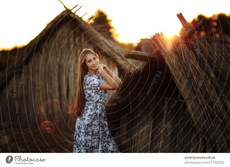 beautiful Young woman outdoors portrait. Portrait of a beautiful girl against a tree house. cute face person lifestyle summer pretty adult caucasian female