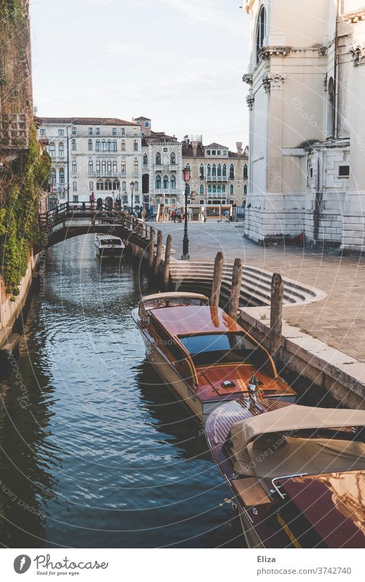 A canal with boats and a bridge in Venice Channel Town Old town Italy Water Watercraft Port City Tourist Attraction