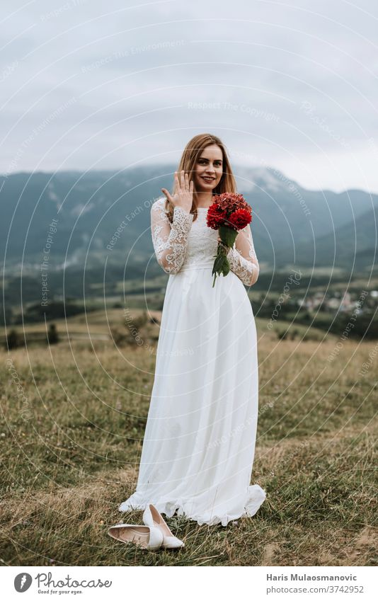Beautiful bride in wedding dress holding ring on the hand, outdoors in nature adult attractive background beautiful beauty bouquet bridal brunette caucasian