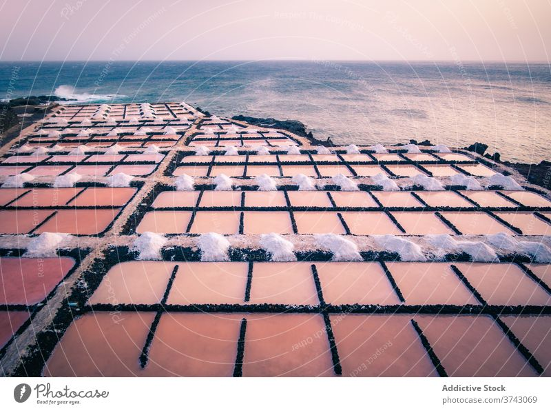 Pink salt ponds near the ocean pink lake seaside coast town aerial water marsh shore spain mallorka landscape beach travel nature destination picturesque
