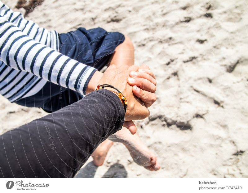 hand in hand in the sand Amber Beach Love Hold hands Family & Relations Protection Hand Infancy Parents Child Son Mother Safety Safety (feeling of)