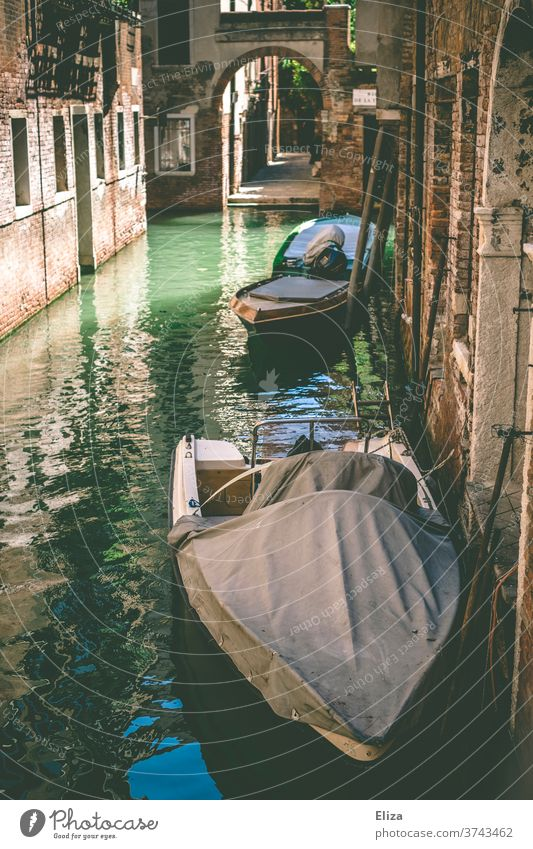 A canal in Venice Channel boat Old town Tourist Attraction arched gateways morbid Town Water Historic