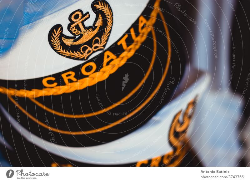 Traditional white sailors hat with the inscription Croatia. Anchor symbol representing the naval forces and the connection with the adriatic sea medieval