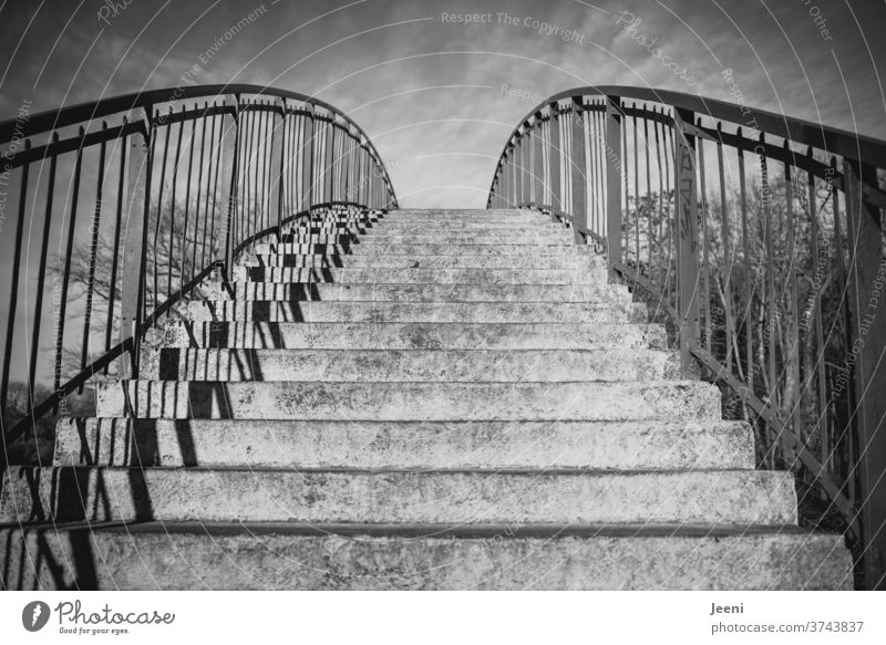 Bridge on the Saale Stage stagger Stairs Banister rail Bridge railing Metal Stone Sky Shadow Grating External Staircase Black & white photo black-and-white