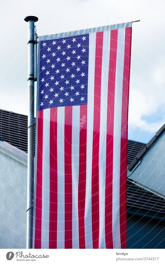 US national flag in front of a building. USA Flag Americas Ensign American Flag Flagpole full-frame image Patriotism Sky House (Residential Structure) Stripe