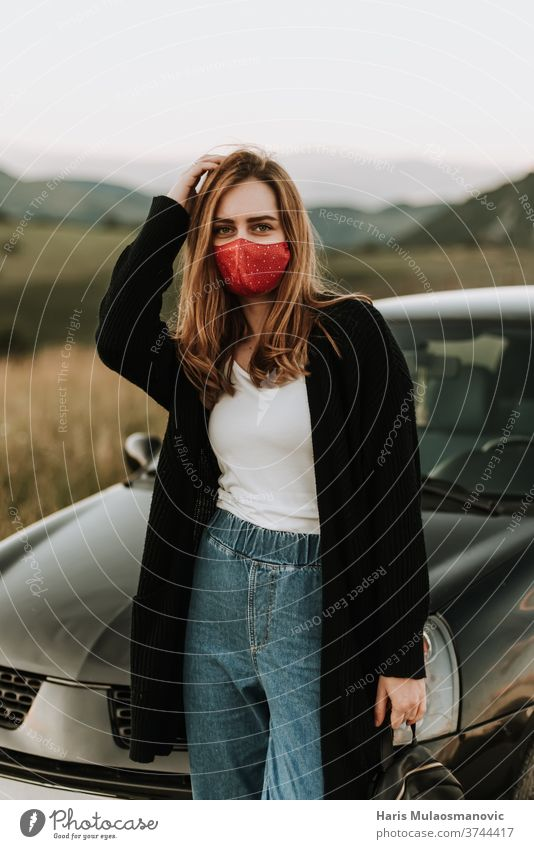 Young woman with mask in solo adventures in nature attractive auto beautiful car caucasian drive driver face mask fashionable female happiness happy journey