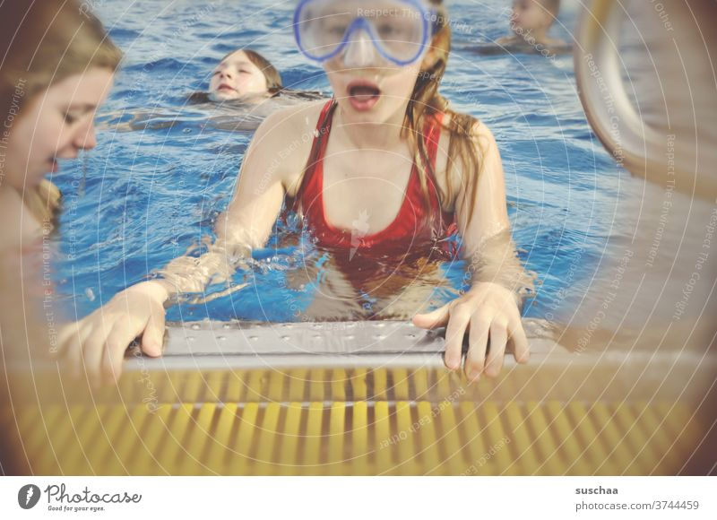 child with diving goggles at the edge of a swimming pool Child girl Pool border Swimming pool Wet Water be afloat swimming lessons Dive Swimming & Bathing