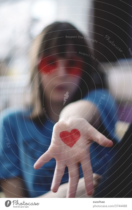young people with painted heart on hand Heart Red Love luck Sign Sincere Affection Indicate Infatuation Romance Heart-shaped Valentine's Day Sympathy Emotions