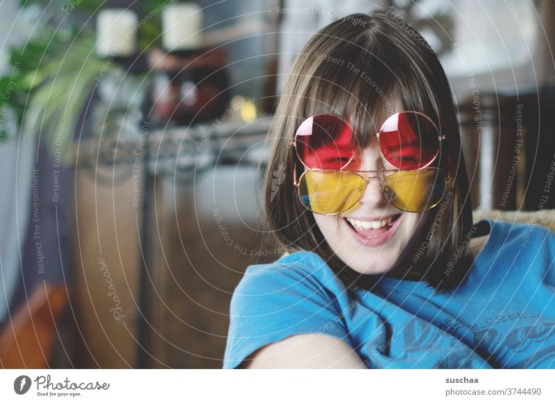 laughing teenager with 2 coloured sunglasses Youth (Young adults) Funny Laughter Joy fun Red Yellow Face Happiness luck youthful girl smile Puberty funny