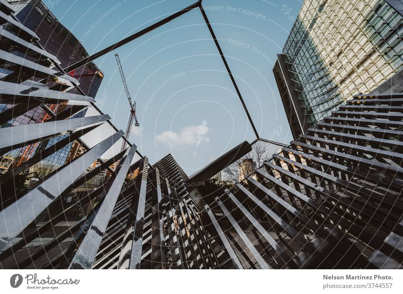 Shot of a Geometric Architecture. View of a square, the sky and buildings. design geometric structure light steel blue architecture modern street staircase