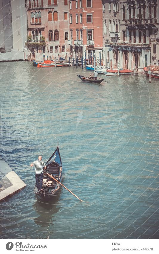 A gondolier in his gondola on the Grand Canal in Venice Gondolier Canal Grande Water Gondola (Boat) Italy City trip Tourist Attraction Channel traditionally