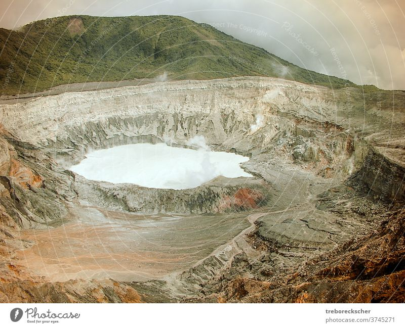 The crater of the Poas volcano in Costa Rica. You can see the acid lake and the barren mountain landscape with the great colors Poison Acid Volcano Mountain