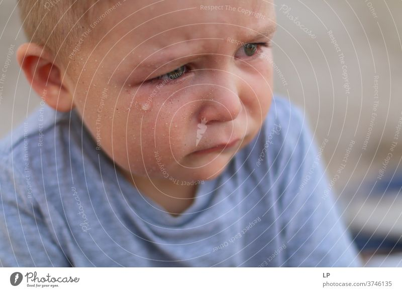 troubled child with a tear on his face Cry Crisis Orphanage Abandoned Left domestic violence Hit conflict management Bruised Hurt Dignity tantrum