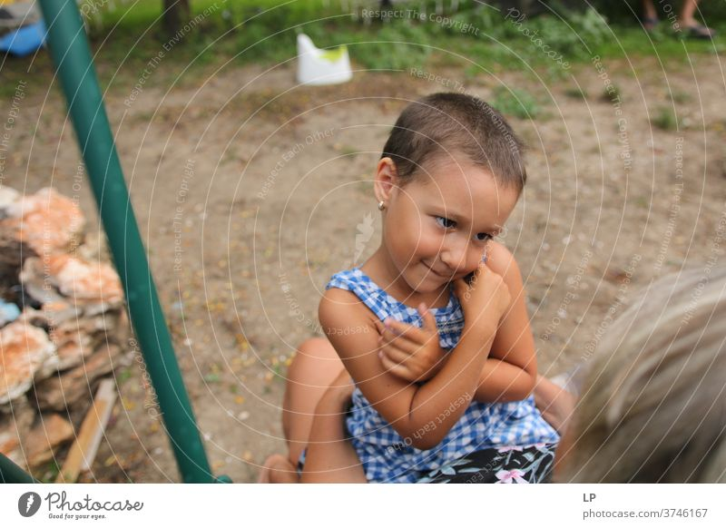 little girl holding her arms on her chest looking and smiling at an adult arms up Protection Body language Human being Emotions Communicate smile hug Gesture