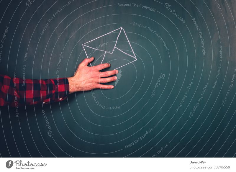 Hand holds letter Letter (Mail) choice by hand voters absentee balloting Politics and state Envelope (Mail) To hold on Communication Information Transmit