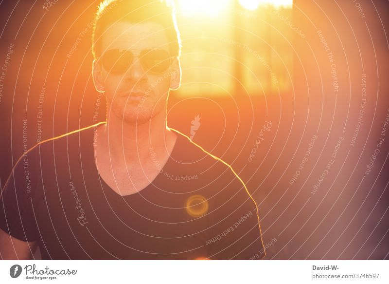 Man with sunglasses in sunlight Back-light Human being sunshine Cool (slang) Sunbeam portrait Illuminate enlightenment Easygoing Sunset