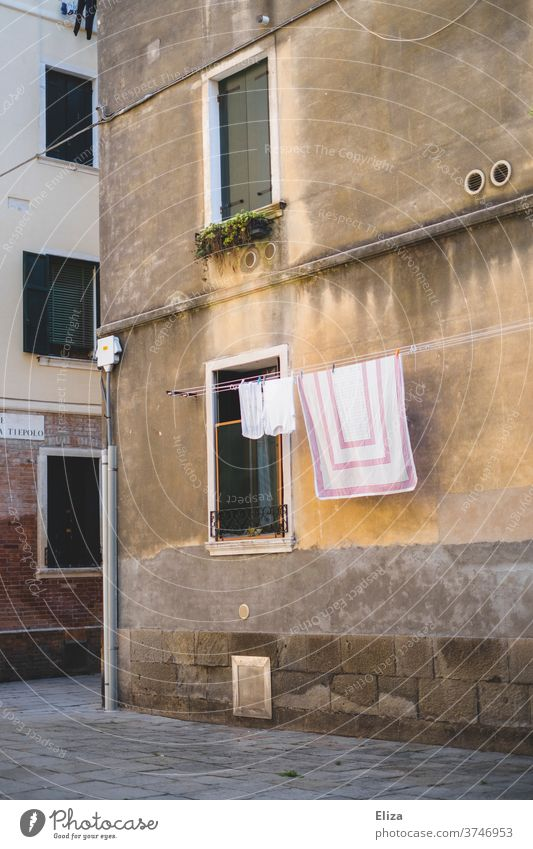 Freshly laundered laundry hanging on a clothesline in a quiet alley in Italy Clothesline Laundry Alley out Old town Facade Living or residing Dry