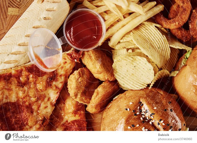 Unhealthy and junk food. Different types of fast food on the table, closeup unhealthy fat american meal eat restaurant pizza diet hot fried menu dog burger