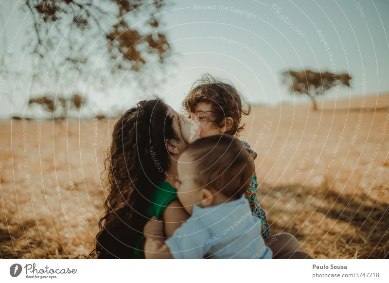 Mother with two childs in the fields motherhood people Child childhood care Family & Relations Love Parents Happiness Lifestyle Infancy Woman Hold Smiling