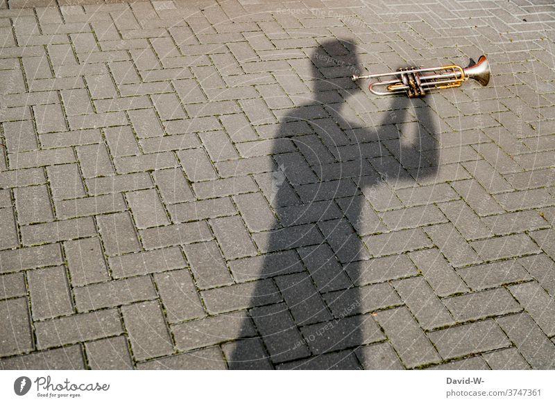 Shadow player - man plays trumpet Music Musician Culture Art Artist Musical instrument corona Human being interdiction creatively Trumpeter