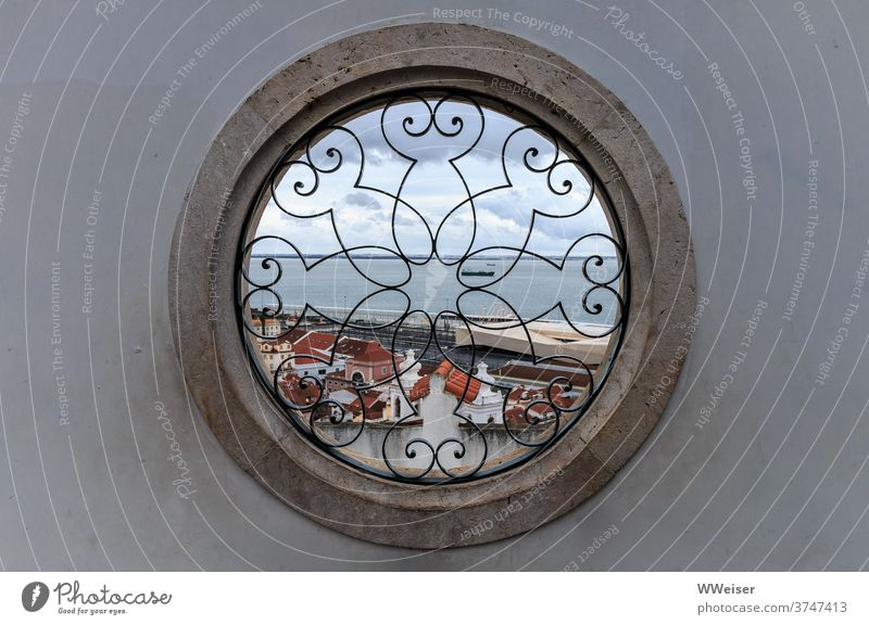 Through the round window you can see the roofs of Lisbon and the Tejo opening Window Pattern Vantage point ship outlook Old town height Bairro Alto Upper Town
