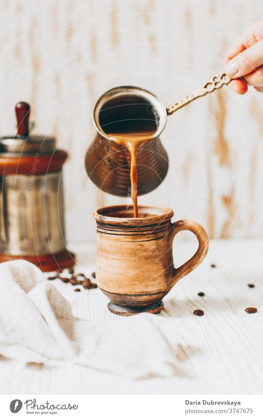 pouring coffee to cup, beans on a wooden background aroma breakfast cafe morning drink brown black dark beverage caffeine hot fresh roasted food natural arabica
