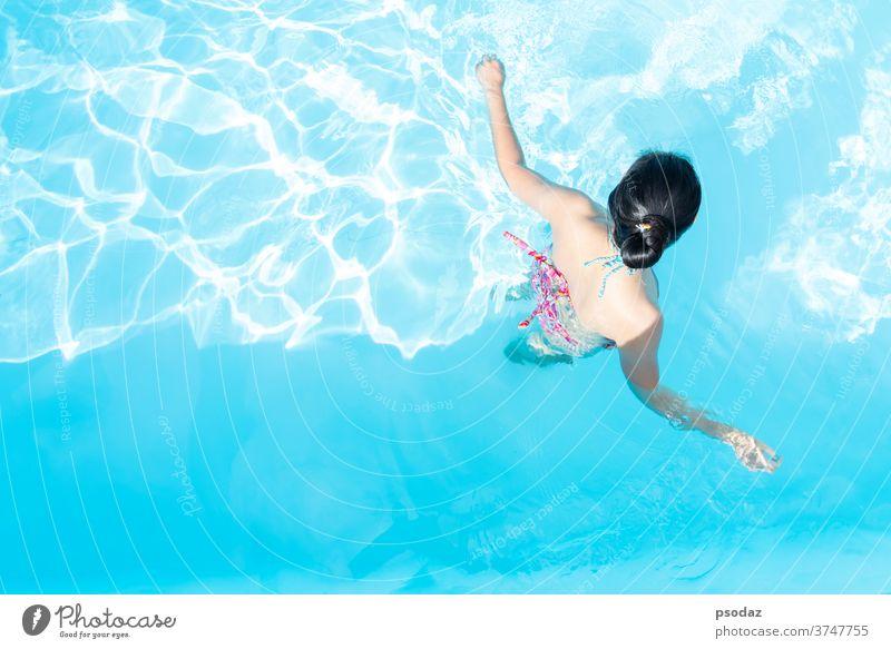 Top view Asia woman enjoy in the swimming pool asia attractive background beach beautiful beauty bikini blue body care fashion female fresh girl hair happy head