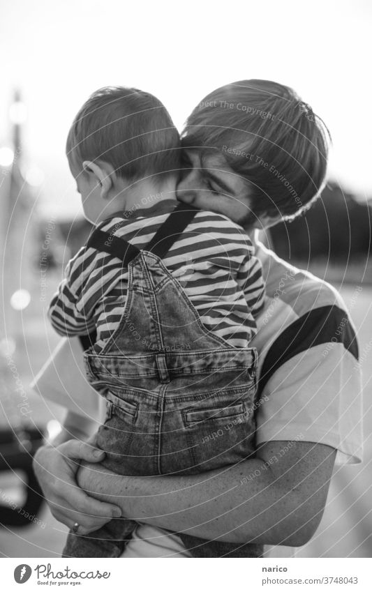 Father holds son lovingly in his arms Toddler Boy (child) Child Exterior shot Infancy 1 - 3 years Nature Overalls Life Human being Shallow depth of field Son