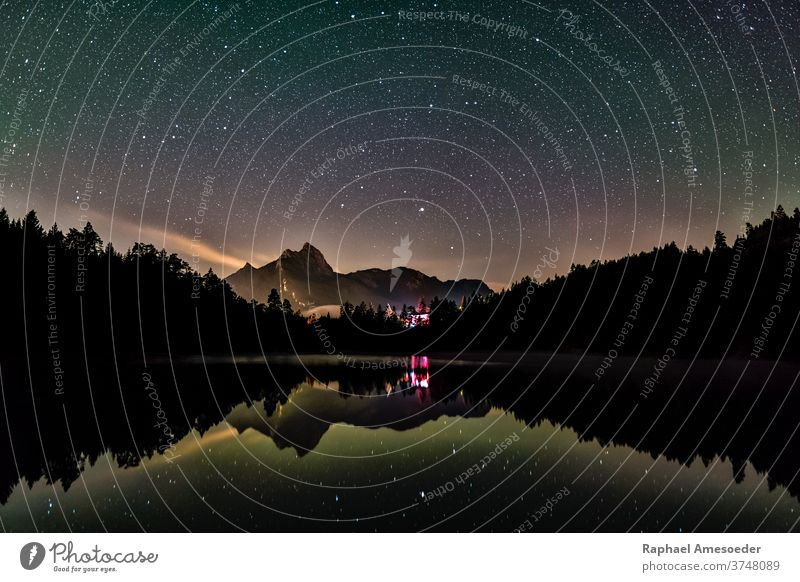Night sky reflection in lake Urisee with alps mountains in background urisee stars reutte astro astronomy austria beautiful blue clear color colorful