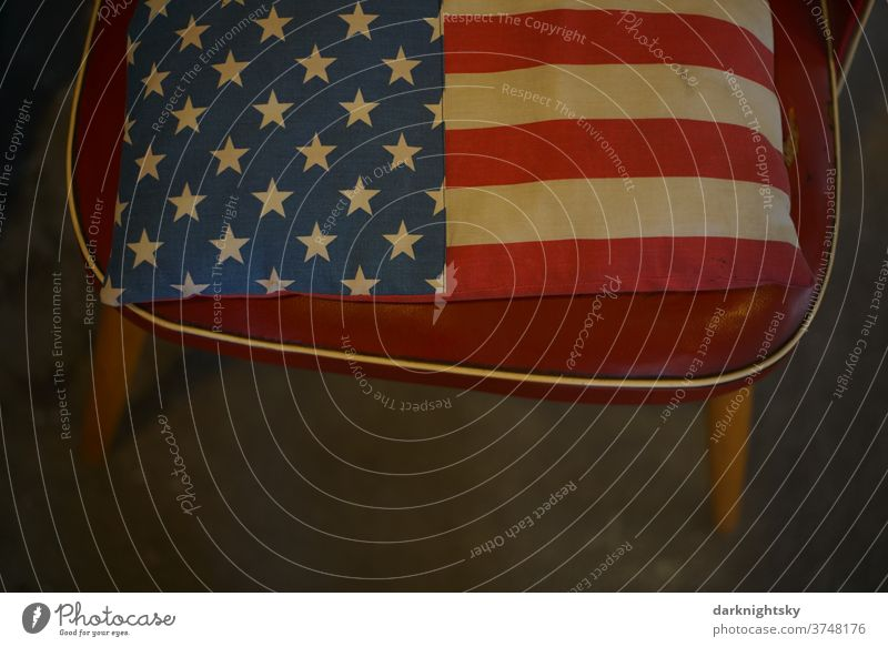 Chair with cushion and flag of the United States of America National Flag USA Americas stars Stripe Freedom Blue Symbols and metaphors Patriotism patriotically