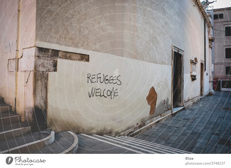 Refugees Welcome - also in Venice :) refugees welcome Fugitives Safe haven Graffiti Help Characters Humanity policy Solidarity Politics and state Responsibility
