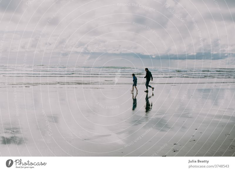 Father and son silhouette running on Oregon beach Silhouette Reflection reflections Reflection in the water Reflection & Reflection silhouettes