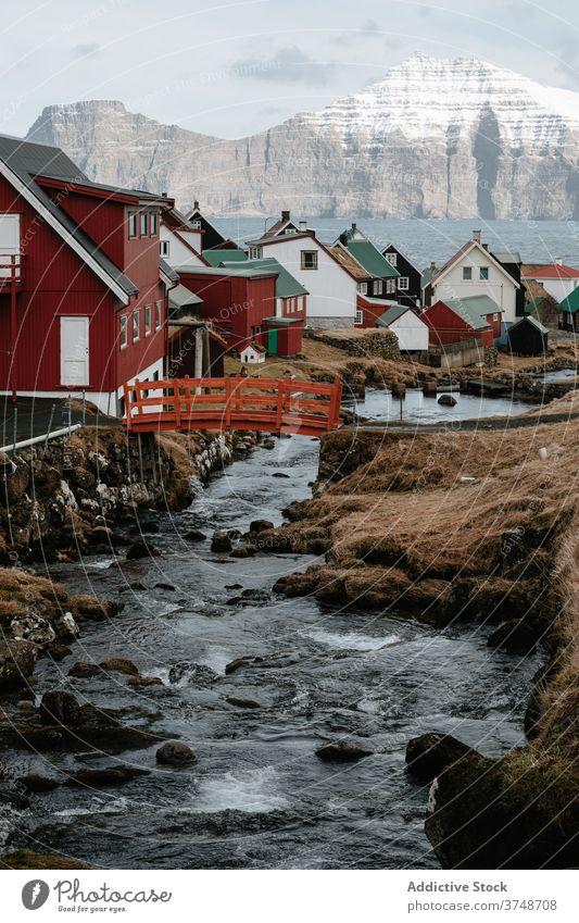 Fast river in village on Faroe Islands settlement fast highland autumn house mountain amazing nature faroe islands landscape countryside serene peaceful calm