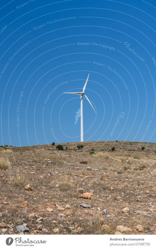 Mountainous landscape with wind energy mills mixing rural life with renewable technologies view mist ecology generation aerial power wind turbines