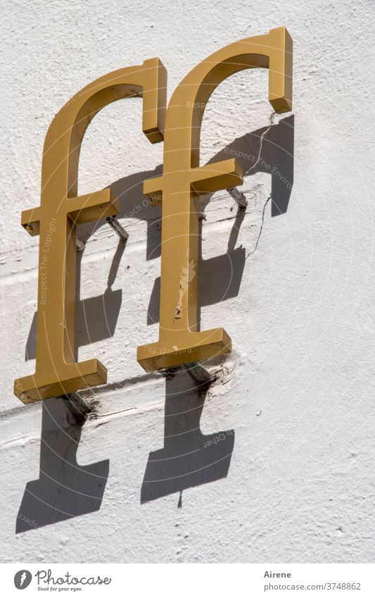 effeff letter Letters (alphabet) FF Gold golden Shadow writing Inscription Heading Italic obliquely Relief house wall Shop Load Storefront pamphlet Serif Metal