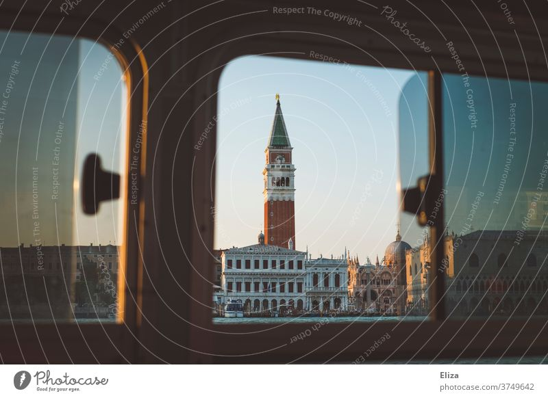View of the Markus Tower in Venice from a vaporetto Markusturm St. Mark's Basilica water taxi Ocean Window Wanderlust outlook view outside Water Italy