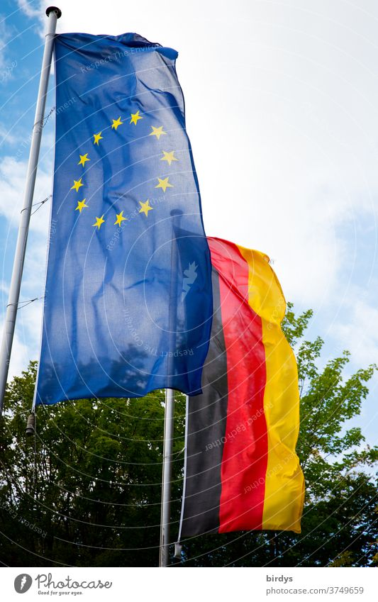 European flag and German flag are waving side by side in the wind. Europe, Germany, flags, EU, European Union Flags brd EU Flag Politics and state Blue stars
