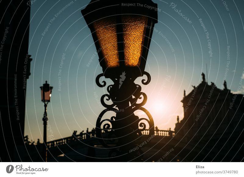 Lantern in Venice at dusk Dusk streetlamp Evening bridge conceit Sky Town squiggled Street lighting Back-light