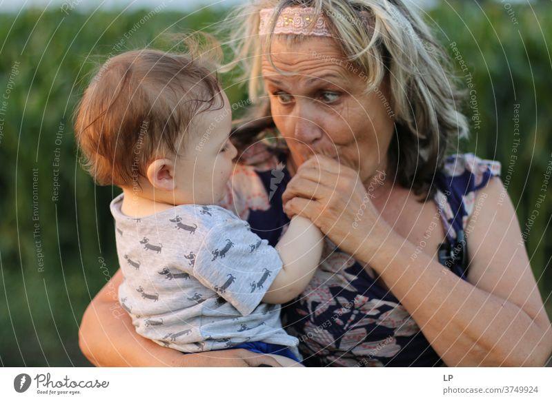 Grandma holding small child and kissing his hands Portrait photograph Love Hugs Truth Trust Joie de vivre (Vitality) Happiness Emotions Life Infancy Couple