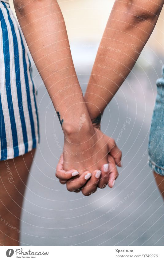 Holding Hands Closeup hands together nails girls sisters faceless love closeup detail holding hands anonymous unrecognized front view portrait two people