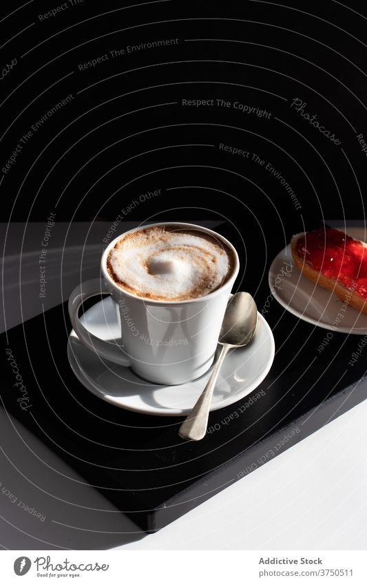 Cup of coffee with white froth on table milk black background traditional coffee shop continental black and white energy toast italian bakery blend daily