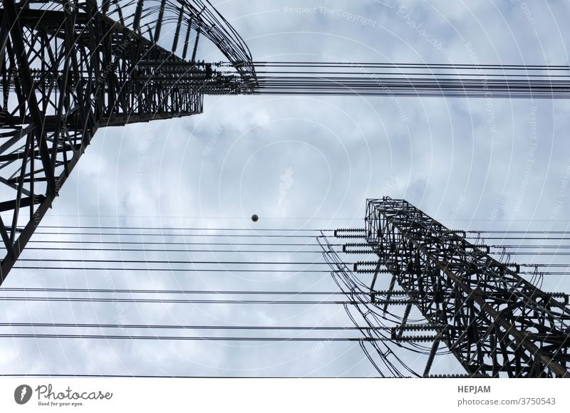 Close up view , high voltage power lines station. High voltage electric transmission pylon silhouetted tower. architecture background cable construction danger